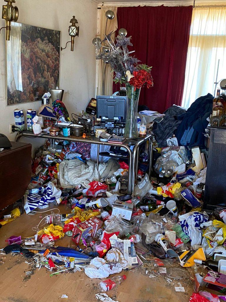 vervuilde woning ontruimen voor